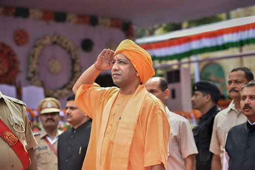 Uttar Pradesh Chief Minister Yogi Adityanath salutes the national flag after hoisting it during the 72nd Independence Day function at Vidhan Sabha in Lucknow.
