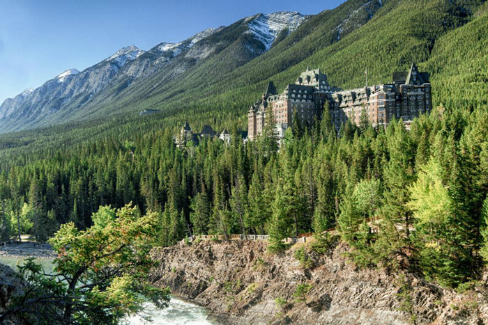 Fairmont Banff Springs Hotel, Canada You have a wide variety of ghosts here: the ballroom dancer who broke her neck, the murdered family or the bellman that helps you to your room. Don't tip him or talk to him – it'll make him disappear.