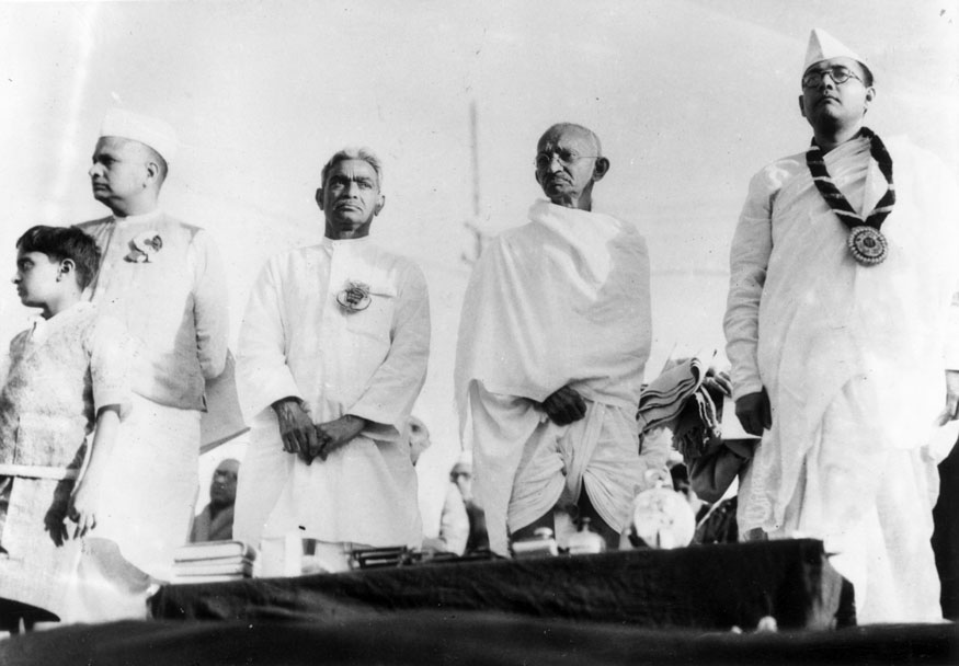 Members of the Indian National Congress on the dais at Haripura. From left to right, Seth Jamnalal Bajaj, Darbar Gopoldas Dasai, Mahatma Gandhi (Mohandas Karamchand Gandhi) and Subhas Chandra Bose