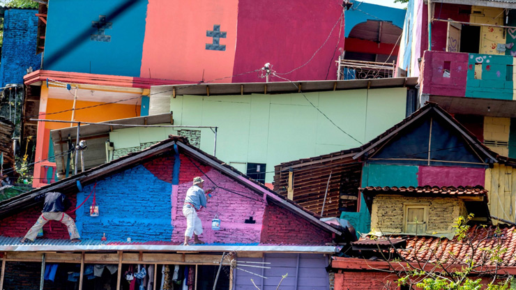 "Workers painting houses at an Indonesian hamlet dubbed ""the rainbow village"" in Semarang, central Java."