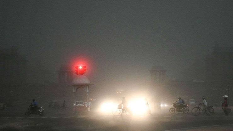 Day virtually turned into night as darkness in the form of heavy clouds invaded the National Capital on Friday in the middle of the afternoon.