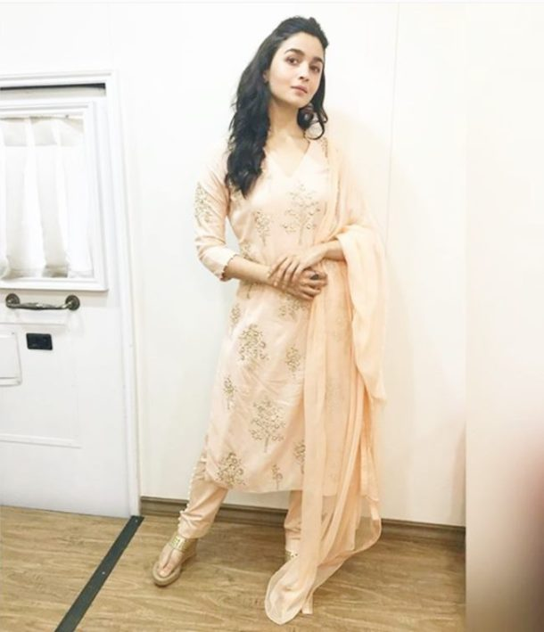 HIT: At a promotional event of Raazi, Alia Bhatt was clad in a lovely badla and pearl embroidered peachy organic bamboo kurta teamed with pearl-edged straight pants and dupatta from designer Varsha Wadhwa.