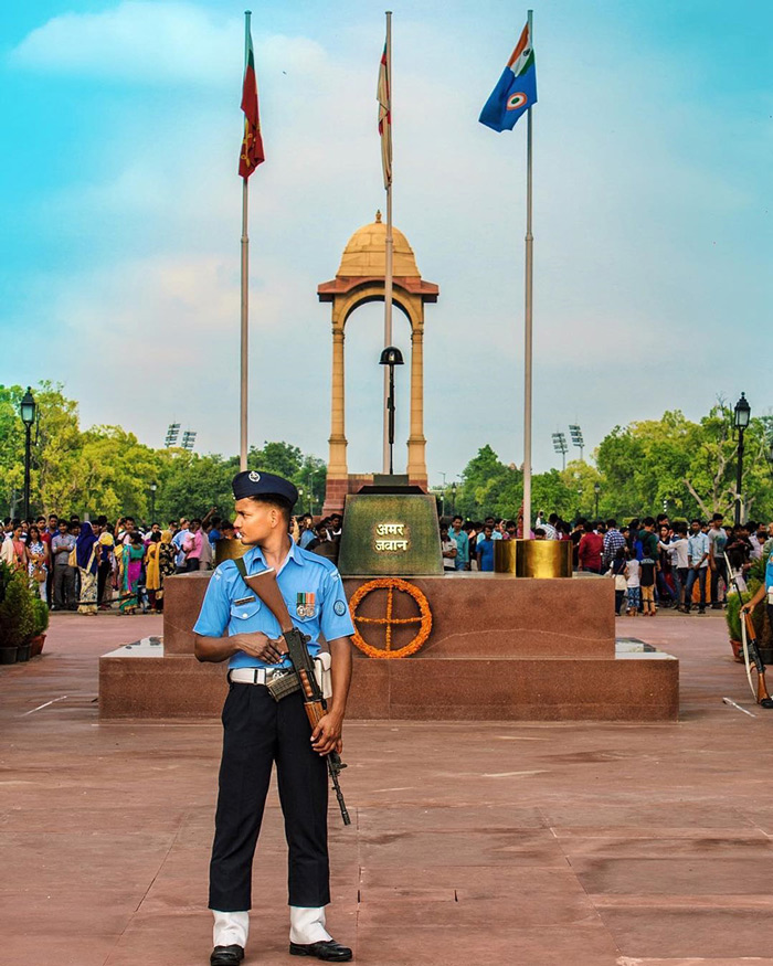 An Indian guard performing the solemn duty of guarding the Amar Jawan Jyoti at India Gate in New Delhi.