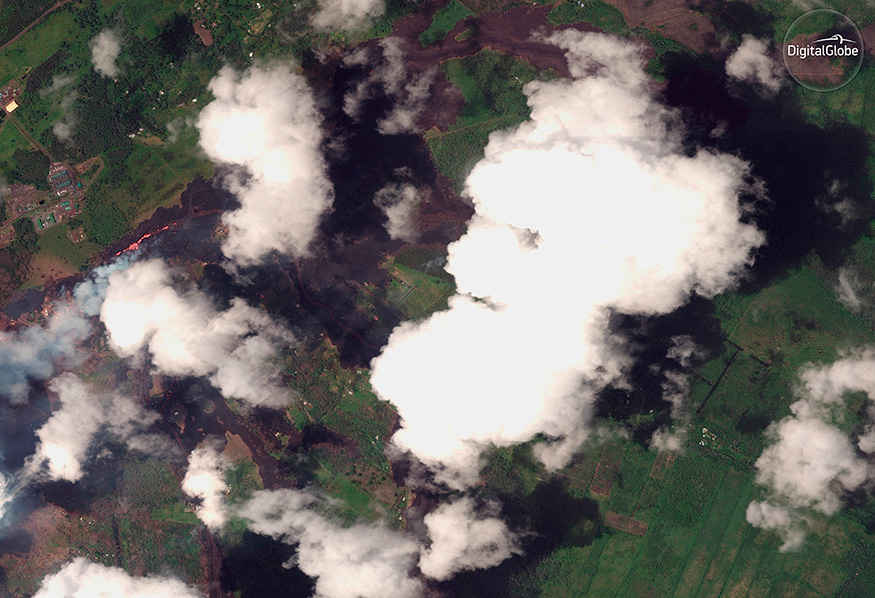 Authorities warned the public to stay away from the toxic steam cloud, which is formed by a chemical reaction when lava touches seawater.