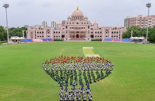 School students make a formation on the eve of Independence Day, in Ahmedabad.