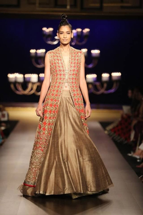 3. Team your lehenga skirt with a long Indo-western jacket with some embroidery work on it to add a fusion blast to your attire.