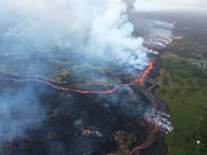 Further upslope, lava continued to gush out of large cracks in the ground that formed in residential neighborhoods in a rural part of the Big Island.