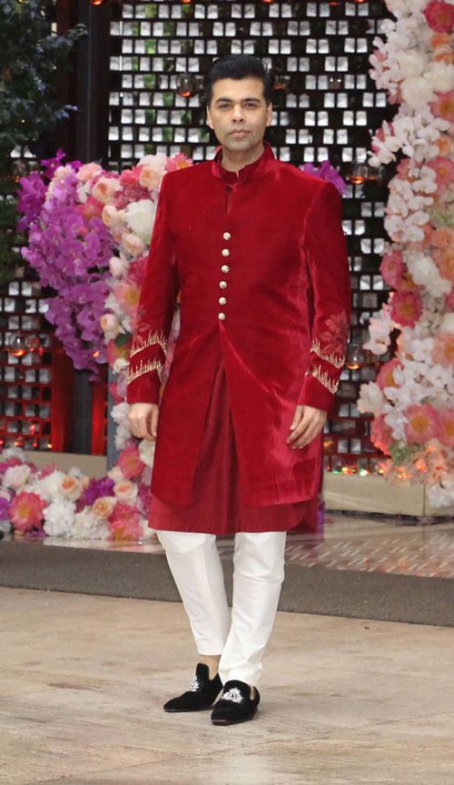 Karan Johar poses for a photo on his arrival at Akash Ambani and Shloka Mehta