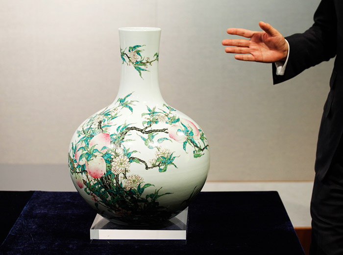 "A fine and rare famille-rose ""peach"" vase, Tianqiuping, with a seal mark and period of Qianlong - This vase is estimated to fetch 10.3 to 15.4 million dollars."
