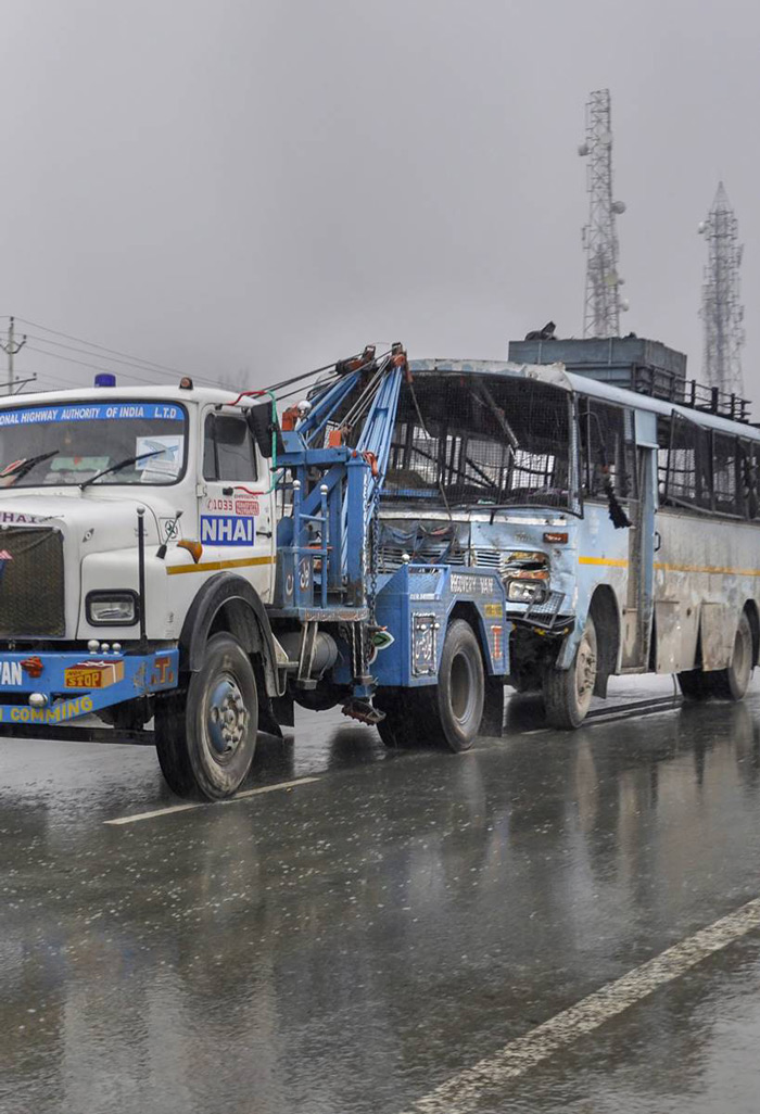 Awantipora: A damaged vehicle of CRPF being taken away from the site of terror attack at Lathepora Awantipora in Pulwama district of south Kashmir, Thursday.