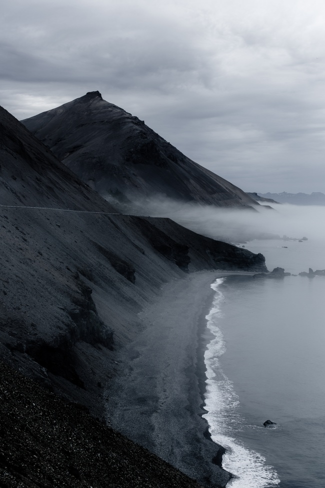A full-color photo of black sand in Iceland