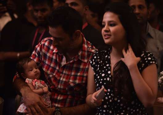 Spending some quality time with his wife Sakshi and their adorable daughter Ziva.