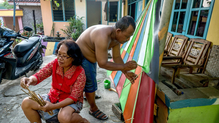 "Villagers painting part of their homes following a major makeover of their Indonesian hamlet dubbed ""the rainbow village""."
