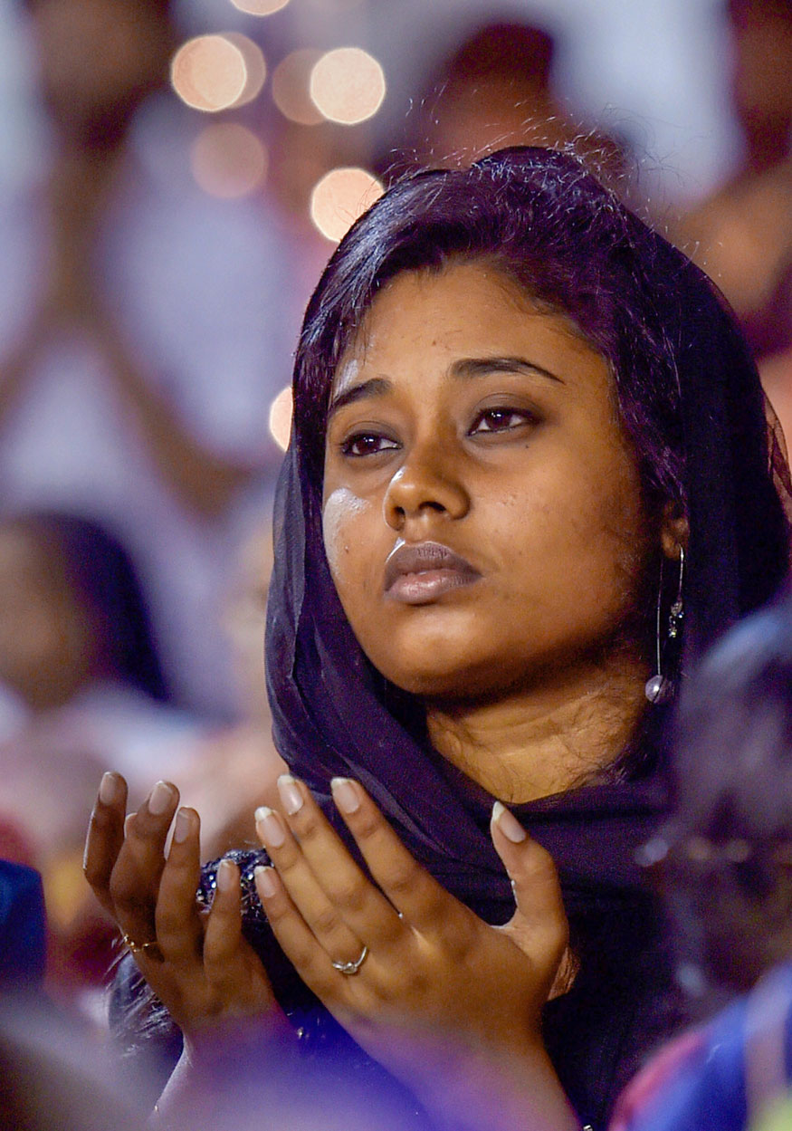 A devotee offers prayers on the occasion of Easter at the Santhome church in Chennai.