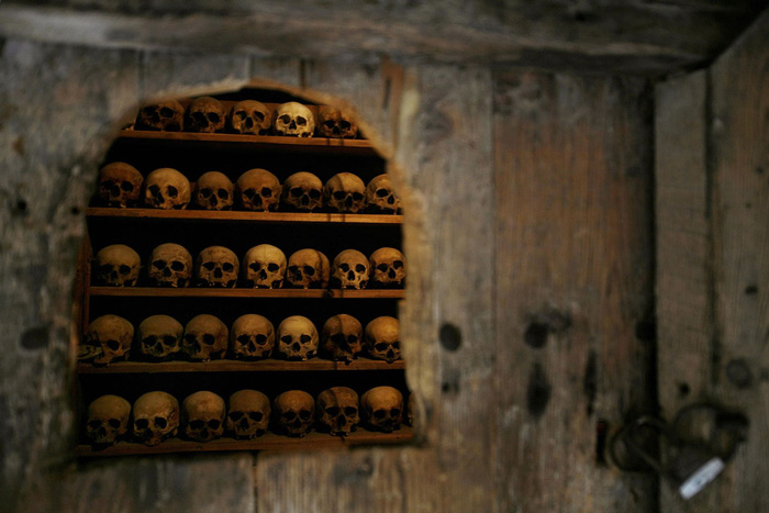 "5.The skulls of deceased monks in an ossuary are seen through a locked door at the Megalo Meteoro, or ""Metamorphisis monastery,"" in Meteora on April 11, 2007. #"