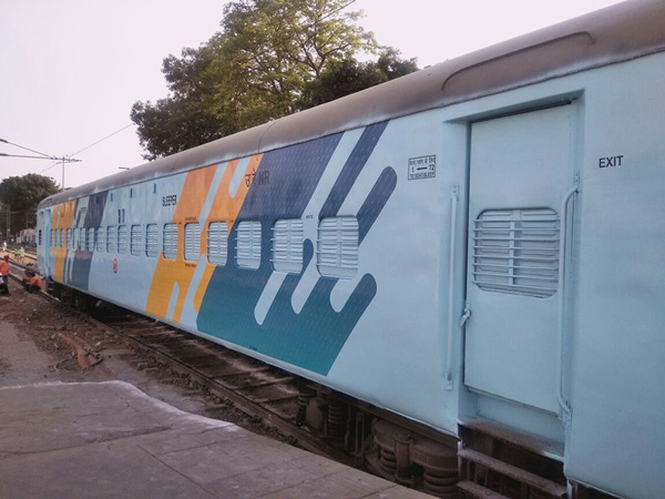 The colour scheme was developed jointly by the National Institute of Ahmedabad and the Railways.