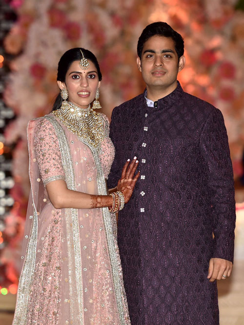 Akash Ambani with Shloka Mehta pose for a photograph
