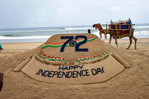 A creation by sand sculpting artist Sudarshan Pattanaik on the eve of Independence Day at a beach, in Puri.