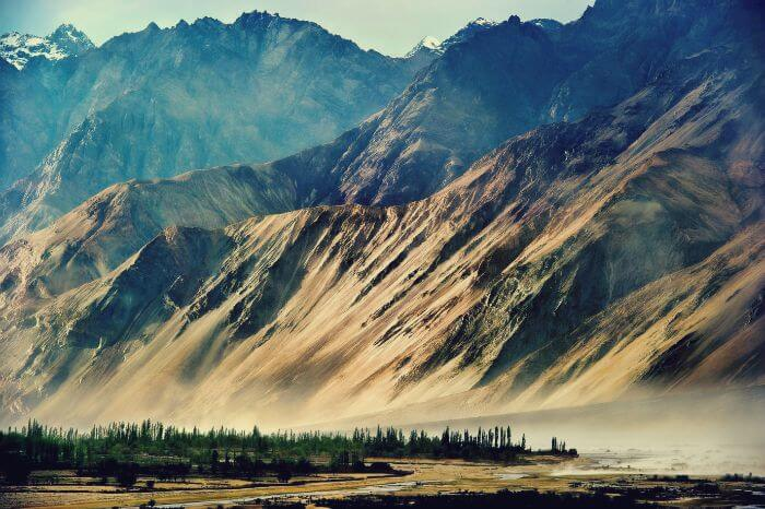 Nubra Valley  Perched between the spectacular Kashmir and mysterious Tibet, lies the Nubra Valley of Ladakh. It's known for its peculiar Balti culture, ancient monasteries, sand dunes, and scenic views that will make you forget about everything.