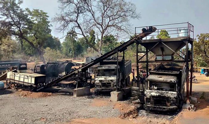 Charred vehicles which were allegedly torched by Maoists, at Kukheda town in Gadchiroli district in Maharashtra.