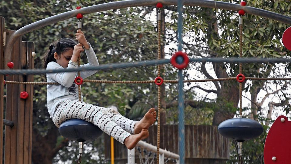 A girl tests the revamped playground at malabar hill