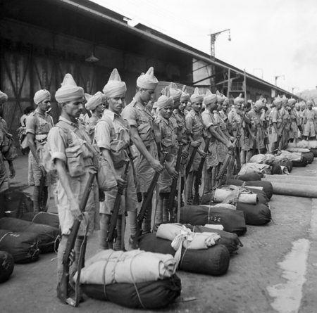 Newly-arrived Indian troops parade on the quayside