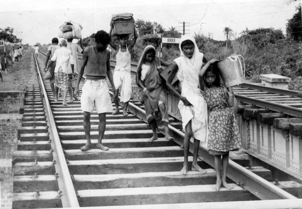 Sometime in 1947, refugees from East Pakistan arrive barefoot in India during the partition. This shot speaks volumes about their grief
