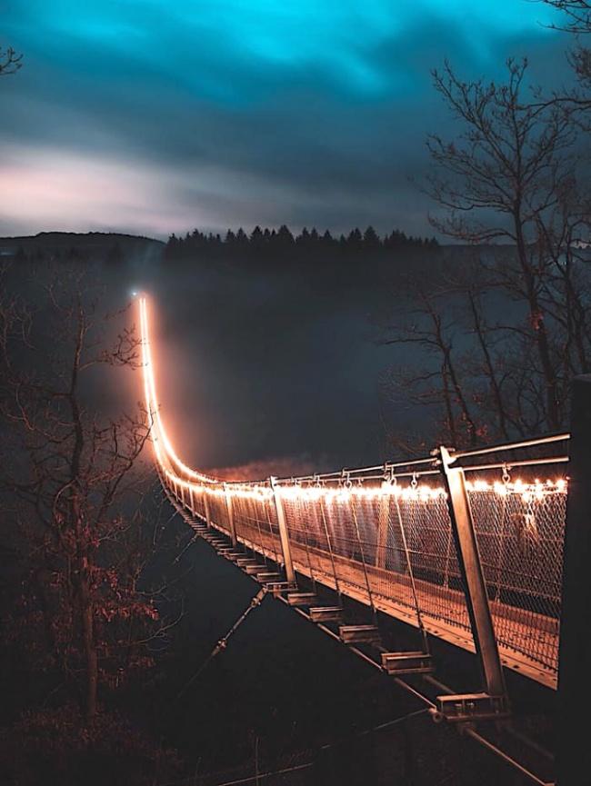 This backlit bridge in the fog looks impressive