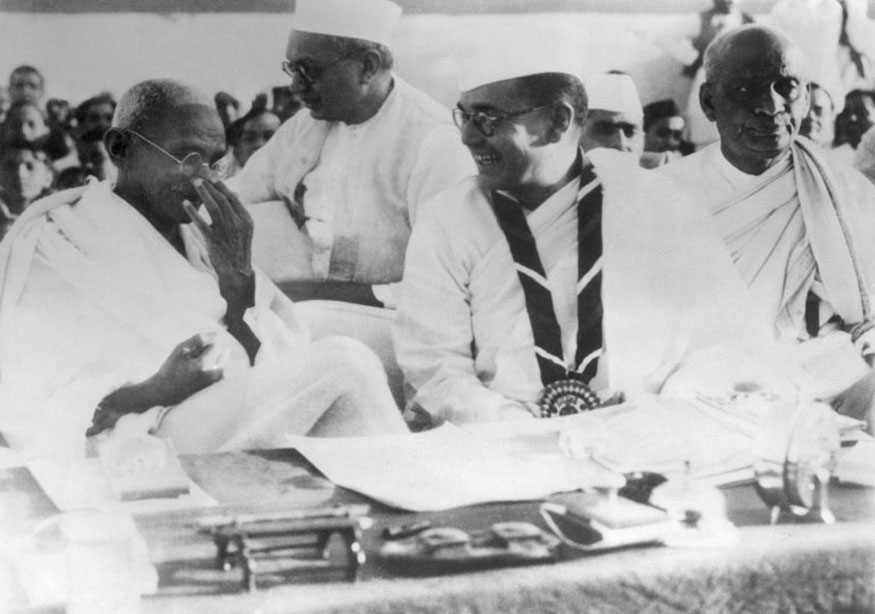 Indian spiritual leader Mohandas Karamchand Gandhi known as the Mahatma Gandhi (1869-1948), speaks with Netaji Subhas Chandra Bose, president of the Indian National Congress in Haripura, during a political meeting