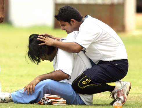 Suresh Raina playing with Dhoni's hair during practice session at the National Cricket Academy in 2006.