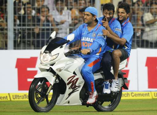 Dhoni riding a bike that we won as the Man of the Tournament in a 5-match ODI series against England in 2011.