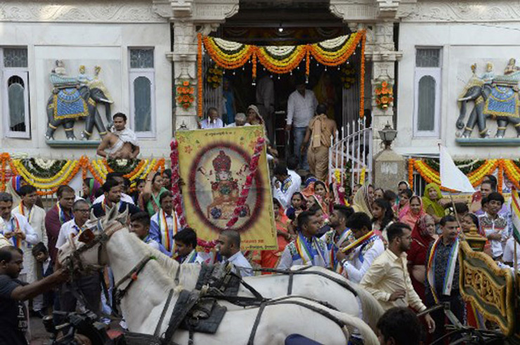 Devotees from the Jain community take part in a procession at an event to mark Mahavir Jayanti at the Sri Mahavir Jain Temple in Hyderabad.