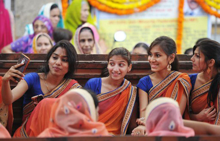 Devotees from the Jain community take a
