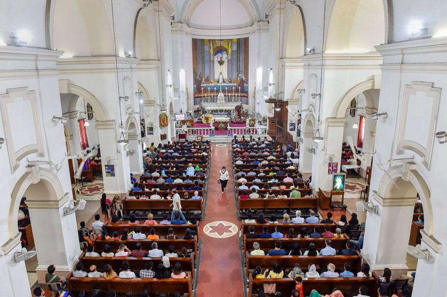 People attend a mass at Sacred Heart Cathedral Church on the occasion of Easter in New Delhi.
