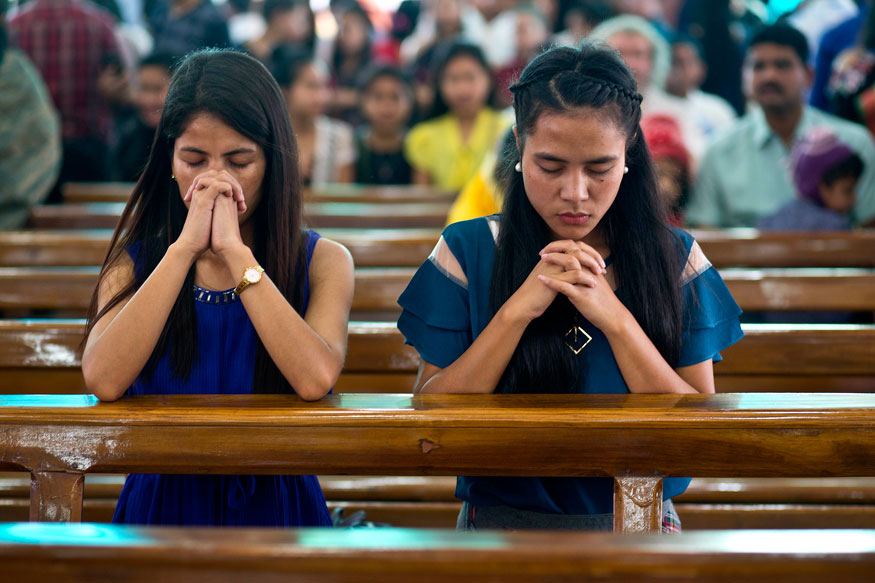 Indian Christians pray during Easter at a Church in Gauhati.