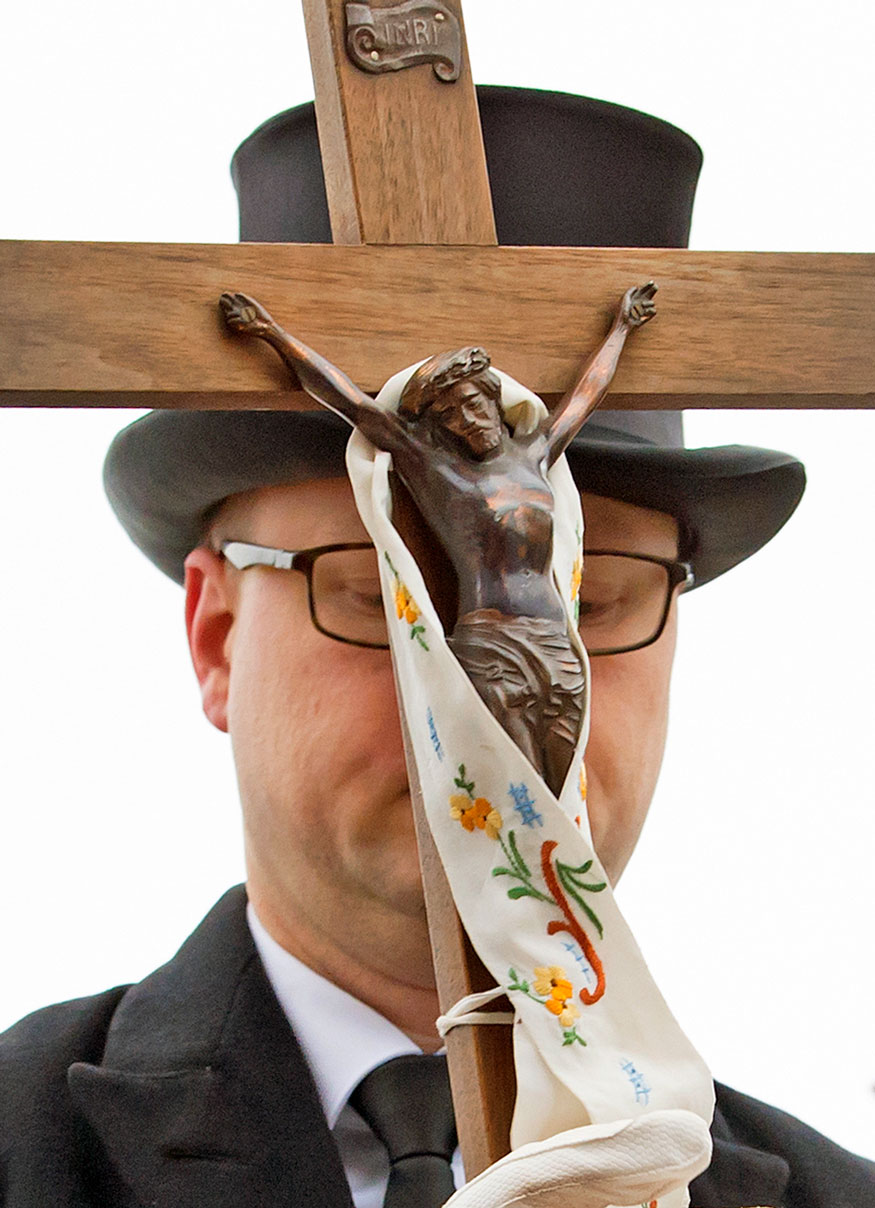 David Statnik holds a crucifix at the beginning of the Easter riders procession in Ralbitz, eastern Germany.