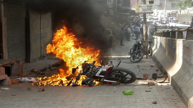 A bike set on fire by the protesters in Ghaziabad.