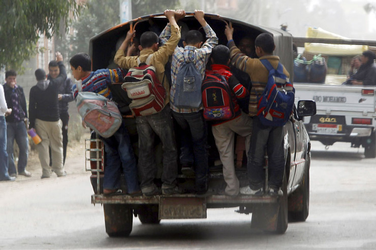 Students travel in a vehicle after attending school at Ibsheway el-Malaq village in Gharbia governorate, northeast of Cairo.