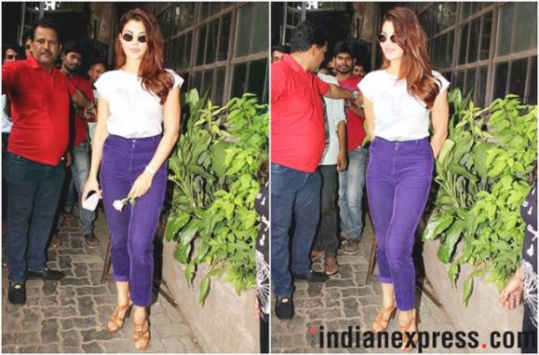 HIT: Jacqueline Fernandez opted for a pair of high waisted purple-coloured pants, which she teamed with a white, tucked-in tee. The lighter shade of the tee complemented the bold-hued jeans very well.