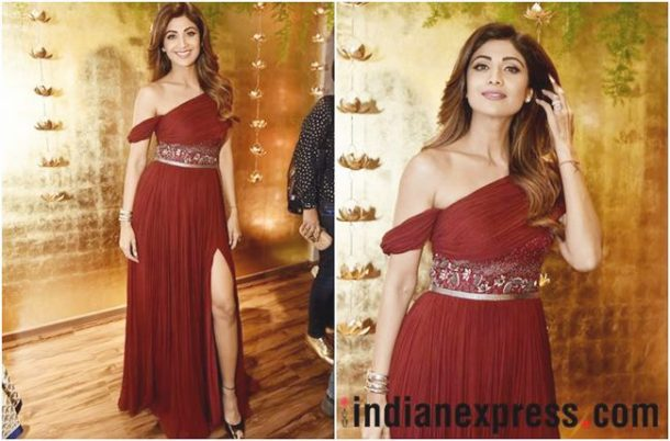 MISS: Shilpa Shetty opted for a burgundy, thigh-high slit gown from Aroka that featured a draped shoulder on one side and a pleated skirt.