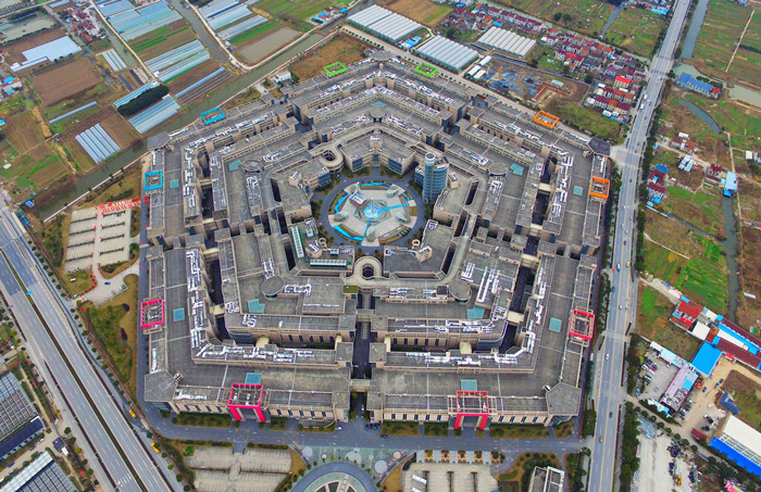 15.An aerial view of Shanghai Pentagonal Mart in Huinan Town of Pudong District in Shanghai. This pentagonal marketplace, resembling the Pentagon in the U.S., became the largest vacant building in Shanghai in January of 2016.