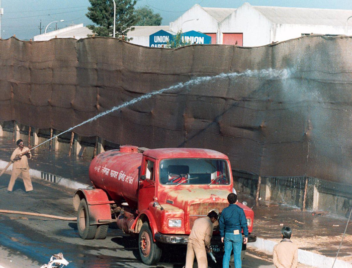 8.Water is hosed onto canvas screens set up around the Union Carbide plant in Bhopal on December 18, 1984, as part of measures taken to avoid further leakage of fumes that had earlier taken a huge toll of deaths and injuries. #