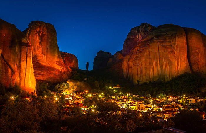 11.Lights from the village of Kalambaka illuminate the cliffs of Meteora at night. #