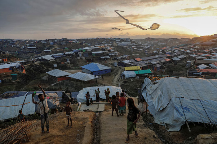 Rohingya refugee children fly improvised kites at the Kutupalong refugee camp near Cox