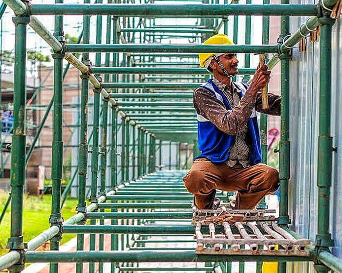 A labour working at a construction site in New Delhi.