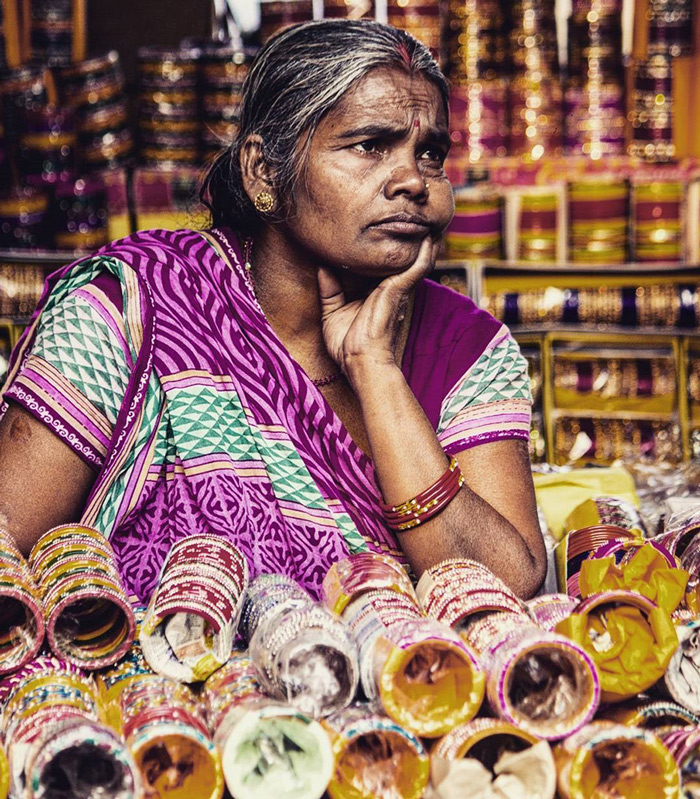 A scene from a bangle accessories shop in New Delhi. A lady worker is seen busy engrossed in deep thoughts.