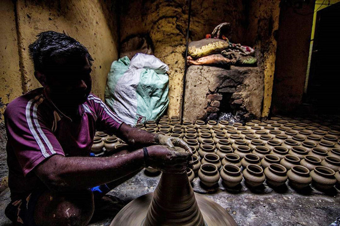 A potter at work in Delhi.
