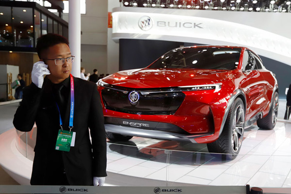 A security person stands near a Buick concept SUV during the start of the Auto China 2018 in Beijing, China.