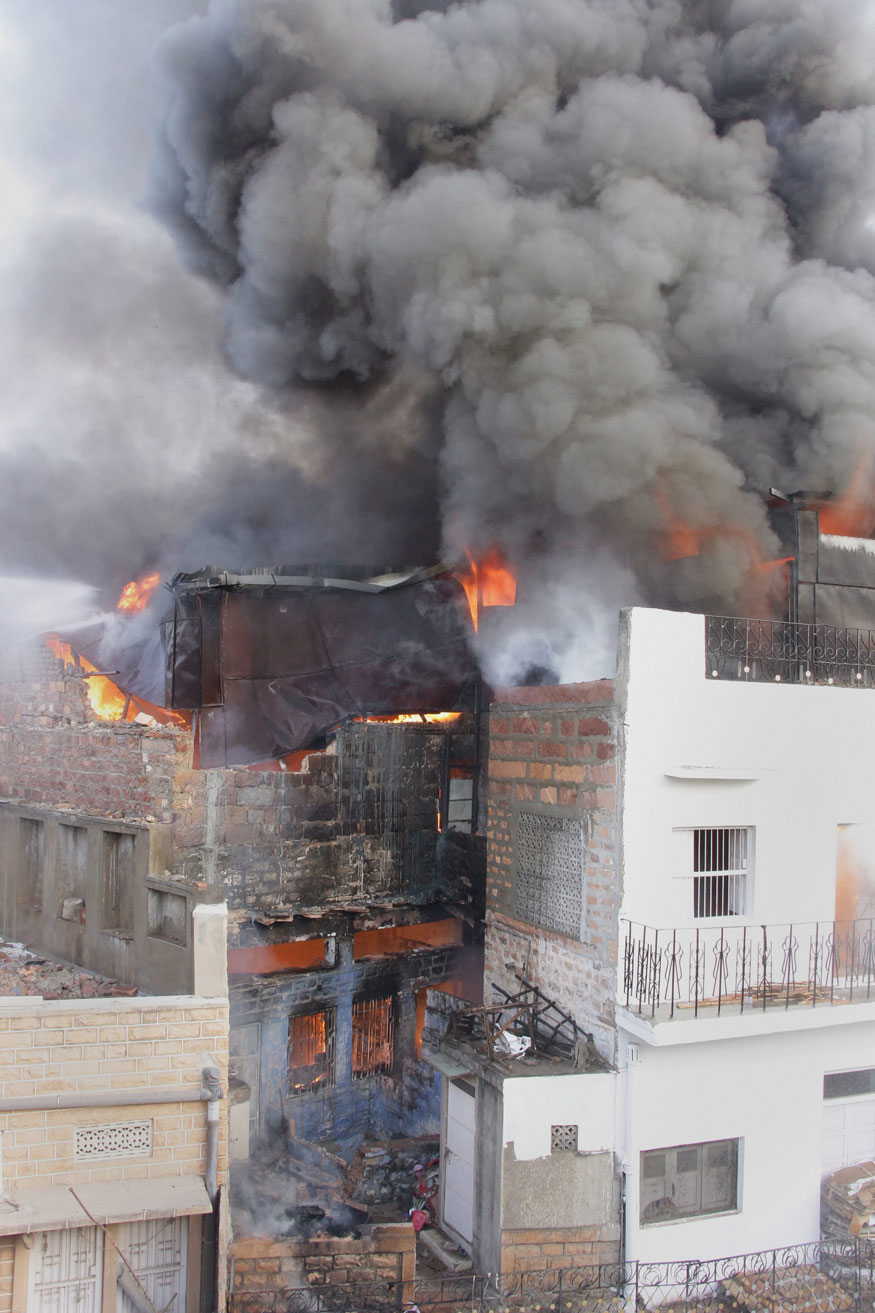 Jodhpur: Smoke rises after a fire broke out in a plastic godown, in Jodhpur, on Monday, May 28, 2018