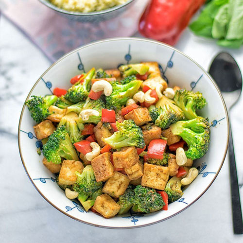 Tofu Stir Fry and Quinoa - Tofu is made from Soy and is a good source of complete protein for vegetarians. Stir Fry Tofu with fresh vegetables and sesame seeds to savour a bowl full of health and happy taste buds for breakfast. You can either have it solo or just add quinoa (another complete protein) for a side serve.